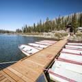 Boat dock with boat rentals at Three Creek Lake.- Three Creek Lake