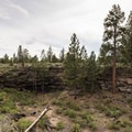 Large lava depression en route to Hidden Forest Cave, part of the Arnold Ice Cave System.- Hidden Forest Cave