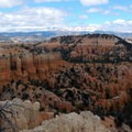 Beyond Bryce Canyon lies the snow-capped upper layers of the Grand Staircase.- Fairyland Loop