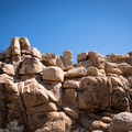 Climbers dot the ridge of a prominent rockpile.- Hidden Valley Nature Trail