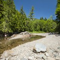 Swimming hole and pebble beach at South Fork Picnic Area.- South Fork Snoqualmie River Picnic Area