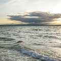 Sunset view of the Olympic Mountains from Carkeek Park beach.- Carkeek Park