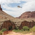 Helicopters fly back and forth bringing visitors and/or gear from the Hualapai Hilltop Trailhead. - Havasu Falls Hike via Havasupai Trail