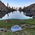 Flat camping area on the east side of the lake. - Stonewall Pass + Echo Lake