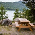 Several picnic tables sit along the lakeside walking trails.- Independence Lake Preserve