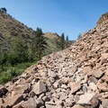 A portion of the trail crosses loose rocks.- Hunter Creek