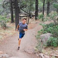 The varied terrain makes a moderately challenging trail run.- Fatman's Loop Trail