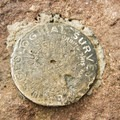 A U.S. Geological Survey marker adorns the summit block.- Bear Peak via Fern Canyon
