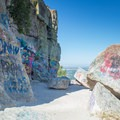 People have left grafitti on many of the cliffs below the summit.- Table Rock