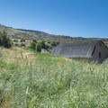 Looking back toward the summit from just outside the walls of the Old Boise Penitentiary.- Table Rock