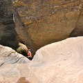 The first rappell lowers down a rock slab, then 12 feet down into a pool.- James Canyon