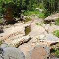 Basalt soon gives way to sandstone as the canyon walls grow higher.- James Canyon