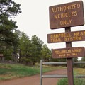 Walk about 300 feet from the parking area to the main trailhead.- Campbell Mesa Trails