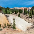The mine sits above a huge tailings pile.- Yankee Girl Mine