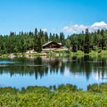 Mesa Lakes Lodge as seen from across Beaver Lake.- Mesa Lakes Lodge