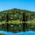 The lodge and some of the large cabins on the lake.- Mesa Lakes Lodge