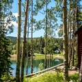 The cabins have great lake views.- Mesa Lakes Lodge