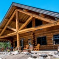 The main lodge building houses a restaurant and bar.- Mesa Lakes Lodge