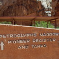 The trailhead is marked by a large sign and has a covered picnic area for hikers to escape the sun.- Capitol Gorge to the Tanks
