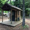 One of two vault toilents in Kinnikinnick Campground.- Kinnikinnick Campground