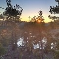 The sun sets over one of the hidden Deadfall Lakes.- Deadfall Lakes + Mount Eddy