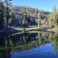 Glassy water on one of the hidden Deadfall Lakes. - Deadfall Lakes + Mount Eddy