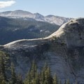 The peaks of the Cathedral Range tower above Lembert Dome in Yosemite's high country.- Yosemite National Park
