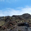 The scramble up to the ridge is rocky and brushy.- Rishel Peak