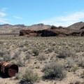 An old oil drum rusts on the flats beneath the peak.- Rishel Peak