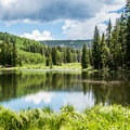 Jumbo Lake is a few steps from Jumbo Campground.- Mesa Lakes Recreation Area