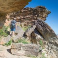 A trail wanders along the cliffs just below the Table Rock Loop Trail.- Table Rock Bouldering Walls