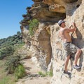 A climber traversing across the sandstone.- Table Rock Bouldering Walls