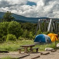 Camping alongside the old railroad bridge.- Railroad Bridge Campground
