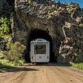 Squeezing an RV trailer through a daunting tunnel.- Railroad Bridge Campground
