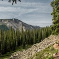 The first third of the trail has nice views and crosses several rock falls.- Ptarmigan Lake Trail
