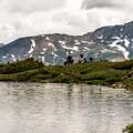 A group of hikers arrives at Ptarmigan Lake.- Ptarmigan Lake Trail
