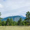 The 12,000-foot San Francisco Peaks shrouded in clouds on a summer morning.- Buffalo Park Hike