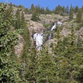 Continental Falls is visible from below on the trail (note the small white cross in the photo).- Mohawk Lakes