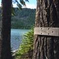 Trail around the shoreline.- Kinnikinnick Campground