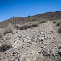 A steep climb up a dry rocky trail marks the way to the summit.- Hidden Valley Summit Trail