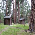 Vault toilets at Ochoco Divide Campground.- Ochoco Divide Campground