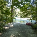 Boat launch and small beach at Goodell Creek Campground.- Goodell Creek Campground + Group Sites
