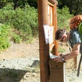 A climber signs in at the Ingalls Way Trailhead (#1390).- Mount Stuart: West Ridge