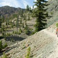 A hiker on Ingalls Way Trail heading toward Lake Ingalls.- Mount Stuart: West Ridge
