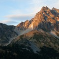 The sun sets over Mount Stuart (9,416').- Mount Stuart: West Ridge