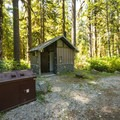 Vault toilet facility at Park Creek Campground.- Park Creek Campground