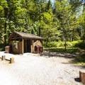 Vault toilet facility at Swift Creek Campground.- Baker Lake, Swift Creek Campground