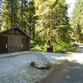 Vault toilet facility at Panorama Point Campground.- Baker Lake, Panorama Point Campground