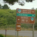 Sign along Highway 101 for Ona Beach and Beaver Creek Recreation Site, also part of Brian Booth State Park.- Brian Booth State Park