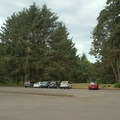 Large parking area just west of highway 101 for Brian Booth State Park/Ona Beach.- Brian Booth State Park